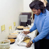 TC Staff Member Unwraps Favorite Dish for TC Potluck