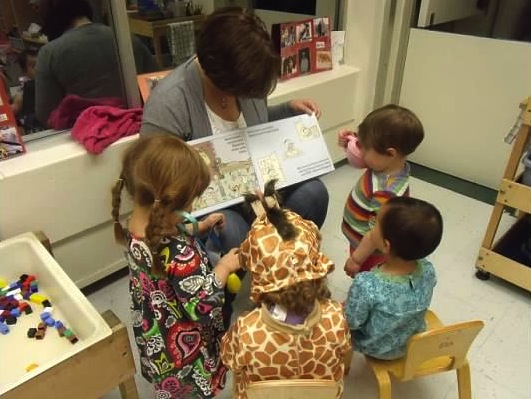 Kara reading with toddlers