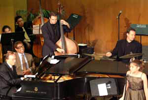 In the Photo: Bert Konowitz and Billy Taylor at the piano with vocalist Sarah Konowitz.