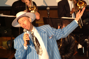 In the Photo: Calloway Brooks sings in the Horace Mann Auditorium.