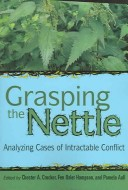 Cover of grasping the nettle