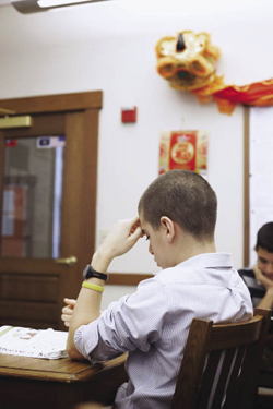 An 8th grader at the Hackley School in Tarrytown, New York, grapples with Chinese.