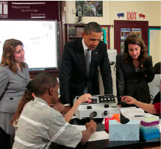 VIP GUESTS Obama and Melinda Gates (right) check out a TechBoston classroom while Skipper looks on