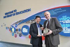 Singapore NIE Director, Professor Lee Sing Kong, with Thomas James, TC
