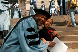 Victor Ramsey, with his three-year-old son, Caleb, on the steps of the Cathedral of St. John the Divine, after receiving his Ed.D. in Biobehavioral Sciences.