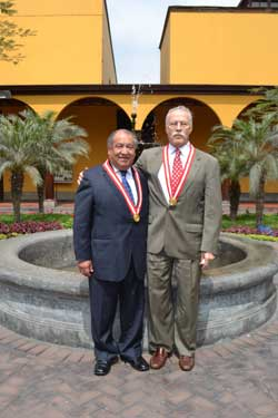 Henry Levin (right) with Elias Mejia, Dean of San Marco University