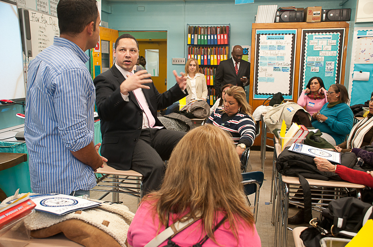 Visiting from Brazil: Principal and TC alumnus Ramon Gonzalez hosts a delegation of educators from Rio at MS 233 in the Bronx (Photograph by Heather Van Uxem Lewis)