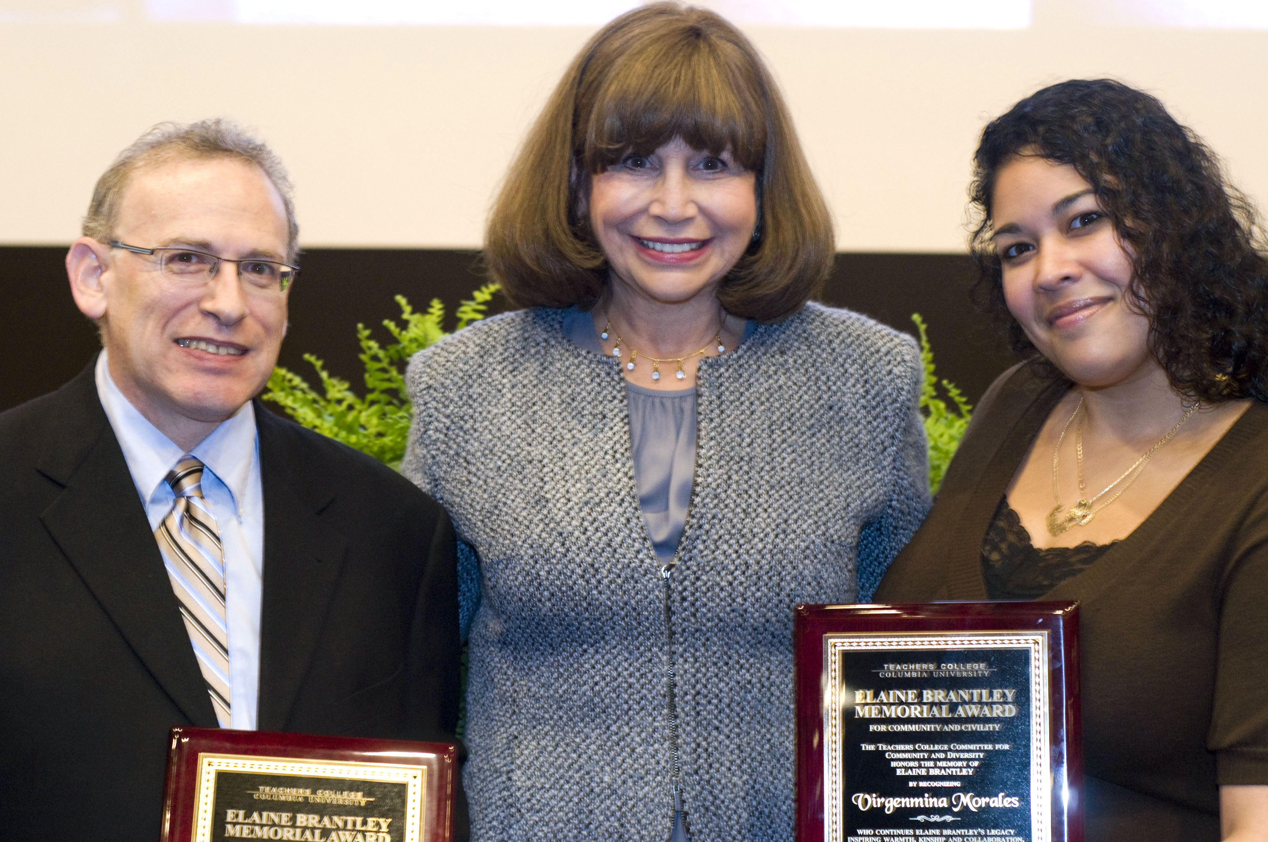 President Fuhrman honors Professor Aaron Pallas and Virgenmina Morales, Telephone Operations Technician, for their community building efforts (Photograph by Heather Van Uxem Lewis)