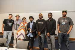 Winner, Jabari Johnson of Urban Assembly School for the Performing Arts (center), with event judges