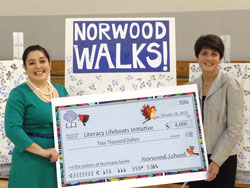 The Norwood School in Bethesda, Maryland, helped TC help schools hit by Sandy. TC's Rosella Garcia (left) accepts a check from Norwood Parent Association President Leslie Wallace. (Photo by Diane D. Berman, Communications Director, Norwood School)