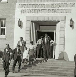 A police escort Ruby Bridges outside William Frantz Elementary School in 1960.