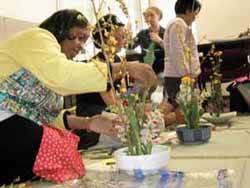In a demonstration of instruction of Japanese Ikebana flower arranging by Makiko Yoshino, Michelle Armstrong, Esther Kang, Kristin Brenneman Eno and Josephine Bautista practice the art form. This exercise showed the uses of self-guided learning from objects.