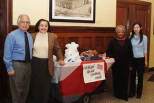 Fred Schnur, Vice President for Finance & Administration, with Janice Robinson, Maudeline Swaray and Kim Chay, Annual Fund Coordinator, with the clothing donated to date.