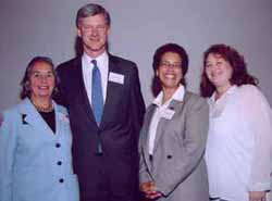TC Trustees Joyce Cowin and William Rueckert, acting President Darlyne Bailey and Laurie Yankowitz.
