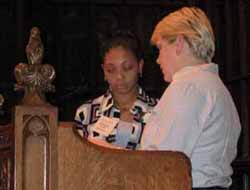 Virginia Stolarski (right) presents the scholarship to Eboné Chemise Brantley at her mother
