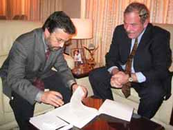 Yunis Qanooni and Arthur Levine sign an agreement to establish the National Academy of Education in Afghanistan.