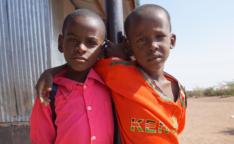 Two boys pose for a photo at Kakuma
