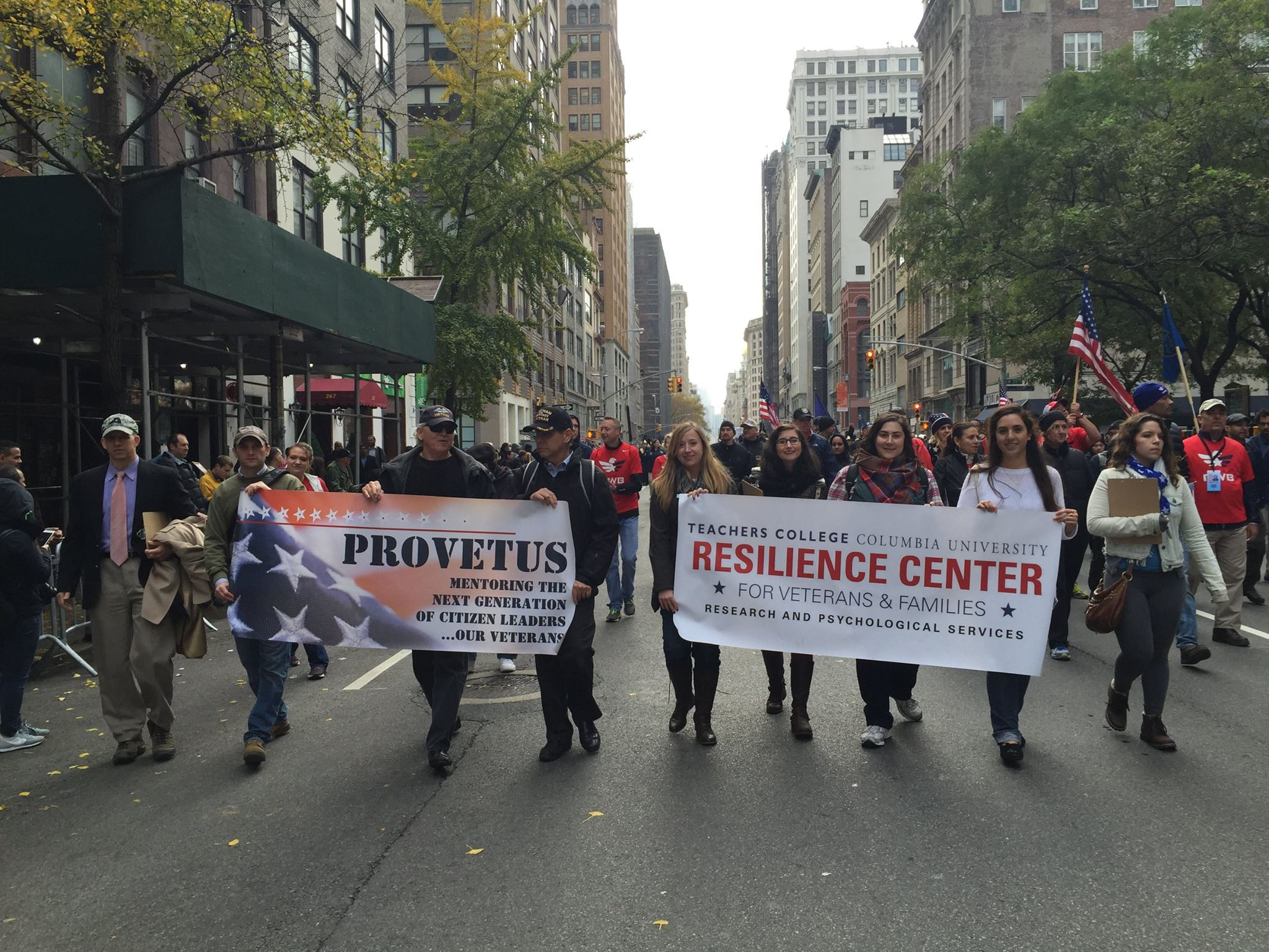 Walking with PROVETUS and Resilience Center banners