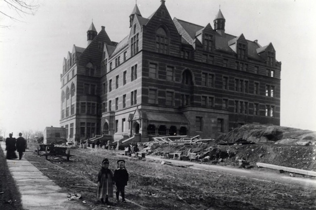 Teachers College Main Building. From The Southeast; Small Boy And Girl In Foreground (1894). Gottesman Libraries at Teachers College, Columbia University.