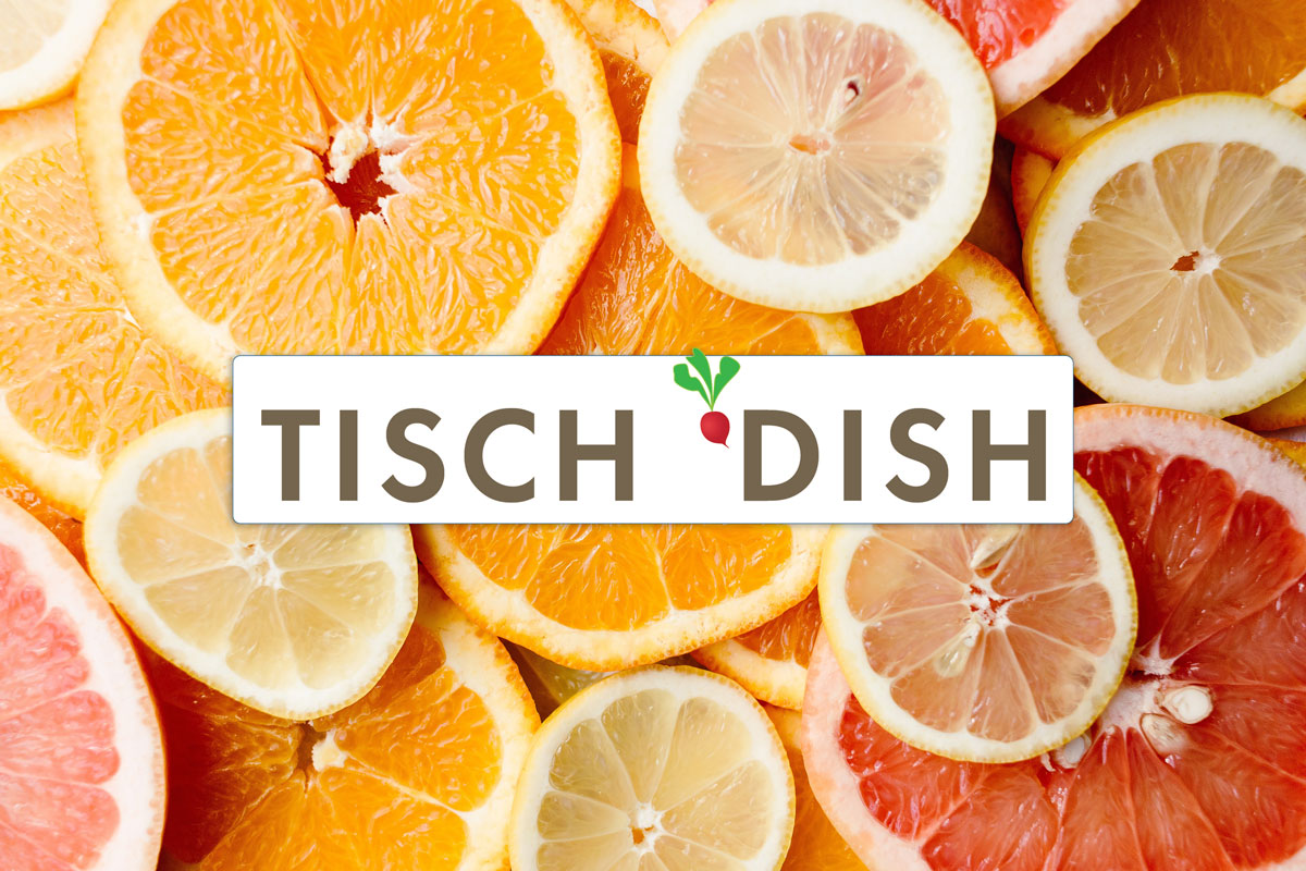 Tisch Dish logo on a background of oranges