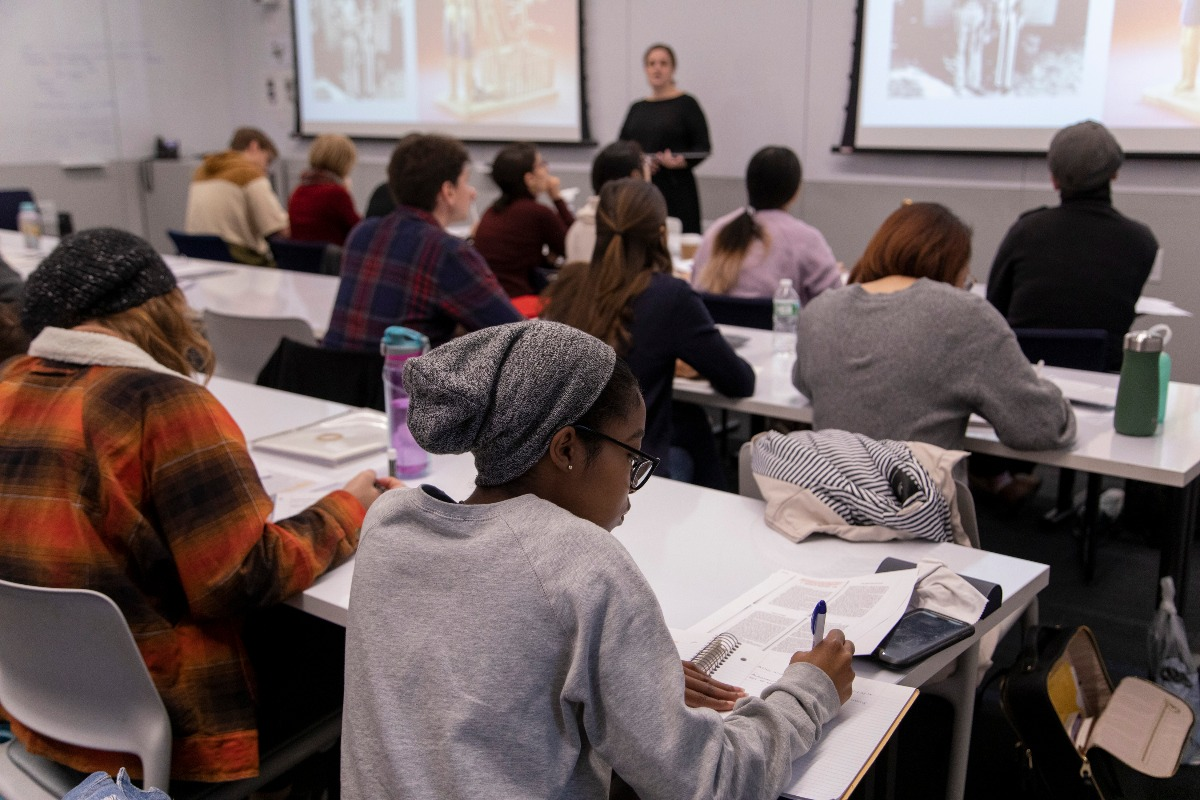 Students take notes in the classroom during a lecture