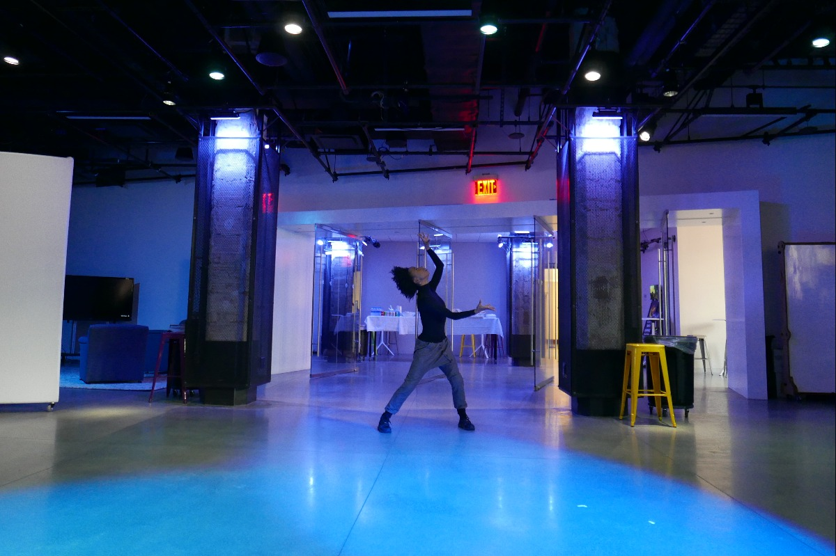 A woman poses at the end of a dance in the Learning Theater at Teachers College