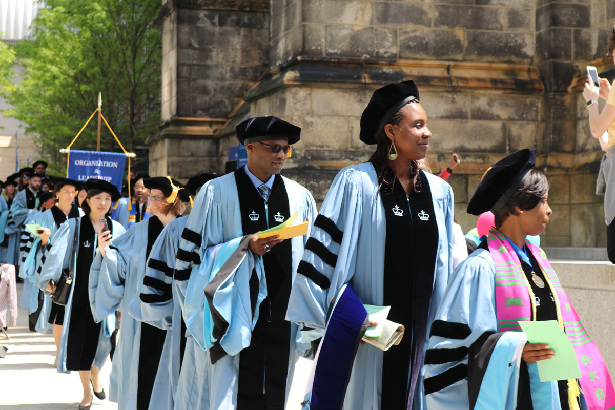 Doctoral students line-up for graduation in their hoods and gowns