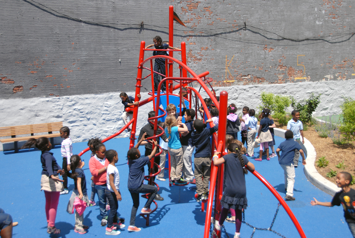 Students play on the playground at Teachers College Community School