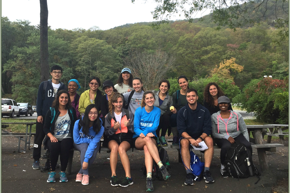 Nutrition students pose for a picture after a hike outside.