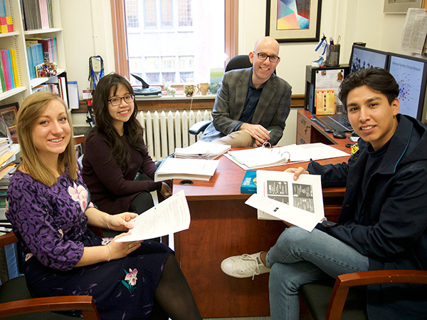 Oren Pizmony-Levy (rear), Assistant Professor of International & Comparative Education, with doctoral student Phoebe Linh Doan (rear, left) and master's degree students Erika Kessler and Jonathan Carmona, all in TC's International & Comparative Education program. (Photo Credit: Desiree Halpern)