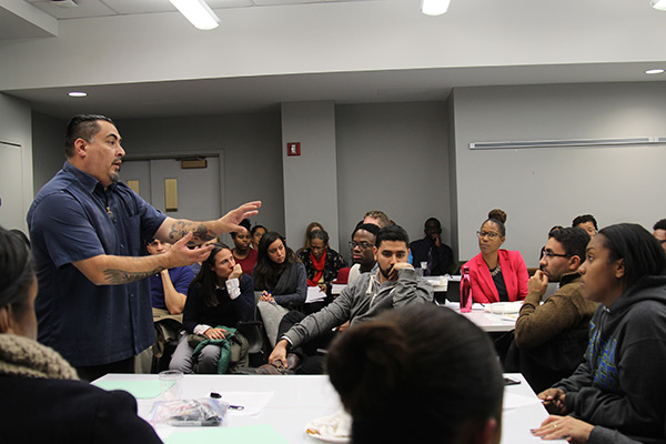Human rights activist Cesar Cruz speaks at the TC Racial Literacy Roundtable in December.