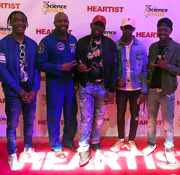 (L-R) Mitch Hunte, Melshawn Richey, Malik Tobias, Kaison Samuell and NASA Astronaut Leland Melvin at the Science Genius Battles, May 26th at the Lowes Paradise Theater in the Bronx