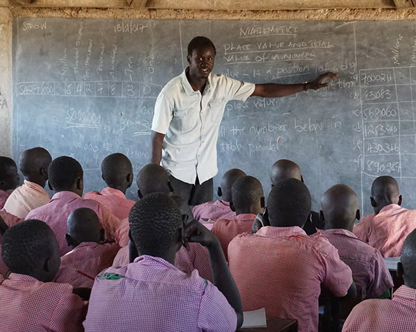 HEROIC EFFORTS Teachers at Kakuma refugee camp, most of whom are refugees themselves and lack formal training, face classrooms of more than 150 students. (Photo Credit: Danielle Falk)