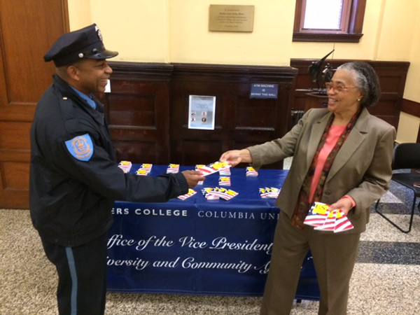 WE THE PEOPLE On Constitution Day at Teachers College, Janice Robinson, Vice President for Diversity & Community Affairs, handed out all seven genuine Articles in Zankel Hall lobby. Public Safety Officer Dennis Chambers (Ed.D.,'10; MA,'02; MA,'99) received his copy.