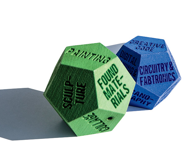 LUCK OF THE DRAWING Students in a class in TC's Creative Technologies program, taught by Richard Jochum, roll these multi-sided dice to set parameters for new artworks they create.