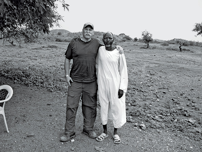 Sam Toten with a survivor of the Darfur genocide