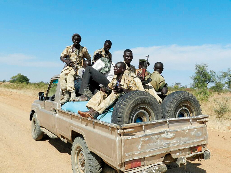 Soldiers in South Sudan sitting on a truck bed