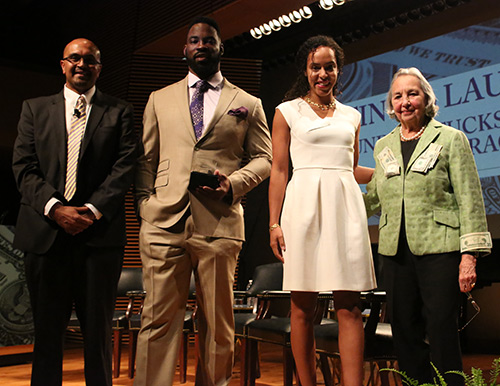 FINANCIAL FAB FOUR Joyce Cowin (M.A. '52; far right), TC Trustee and founder of The Cowin Financial Literacy Program, with (from left) Cowin Program Director Anand Marri, and former New York Giants football great Justin Tuck and his wife, Lauran, founders of Tuck's R.U.S.H. for Literacy. (Photo: Bruce Gilbert)
