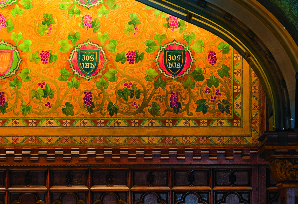 Oak wainscoting, Milbank Chapel's east wall; green and gold paper by Tiffany Glass and Decorating Company. Former TC Trustee President William Potter oversaw construction of Collegiate Gothic-style Milbank, Main Hall and more.